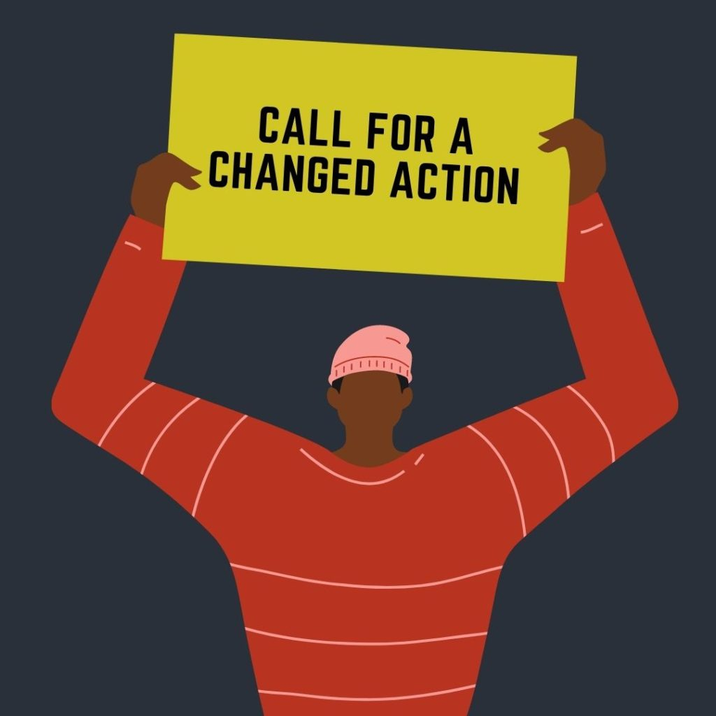 alt= 'man holding poster of changed action'